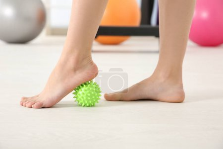 Feet of woman doing exercises