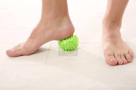 Feet of man doing exercises
