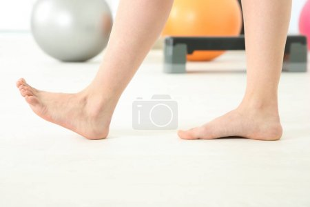 Feet of woman doing exercises