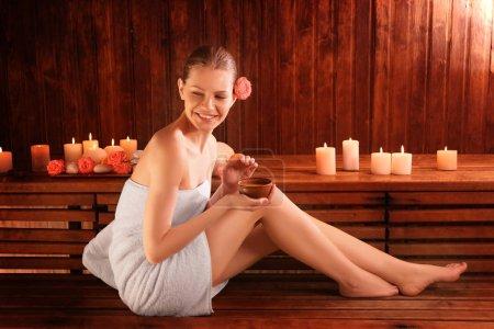 Beautiful young woman in sauna