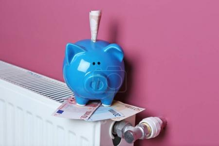 Cute blue piggy bank with money