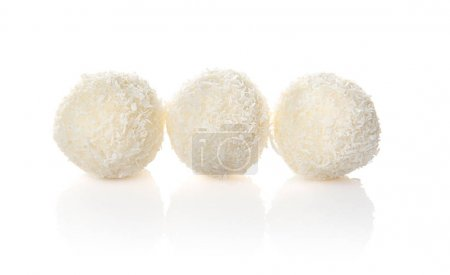 Coconut candies on white