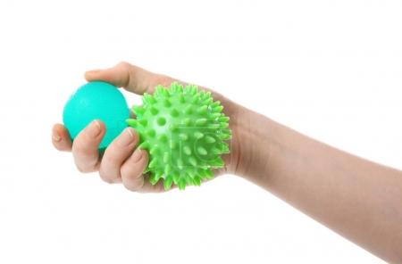 Female hand with stress balls