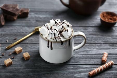 Cup of cocoa with whipped cream, marshmallows and ...