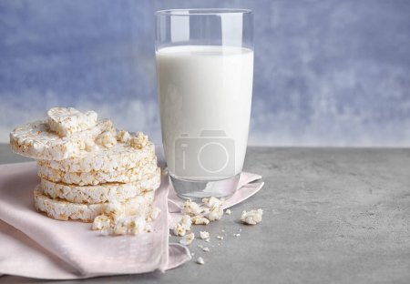 rice wafers with curd cheese and glass of milk