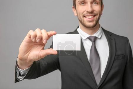 Handsome young man with business card