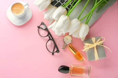 Photo for Composition of flowers, cosmetics and accessories on pink table - Royalty Free Image