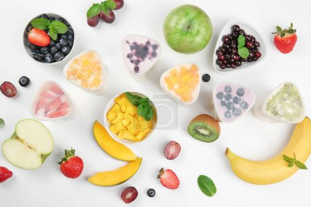 Bowls from automatic yogurt maker with fruits