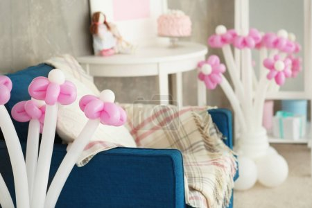 Composition of balloons in room