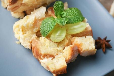 Plate with sliced bread pudding