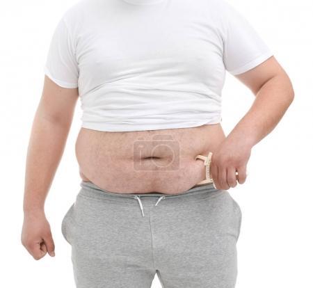 Fat man with measuring caliper