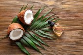 Perfume bottle and fresh coconut