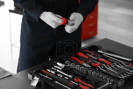 Auto mechanic working  with tools