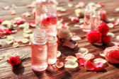 perfume bottles and roses
