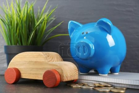 Piggy bank and wooden toy