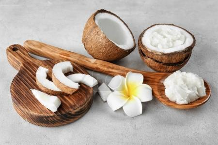 Wooden spoon with coconut oil
