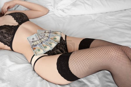 Sexy woman in lingerie with money
