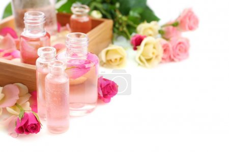 Photo for Beautiful composition with perfume bottles and roses on white background - Royalty Free Image