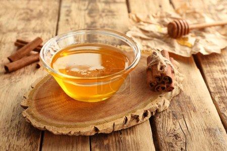 Cinnamon and honey in bowl