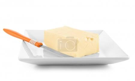 Plate with butter and shovel