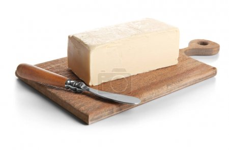 Board with butter on white