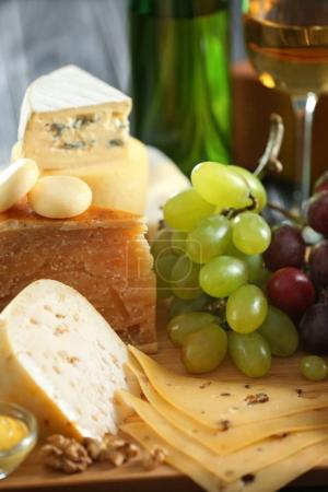 Wooden board with variety of cheese