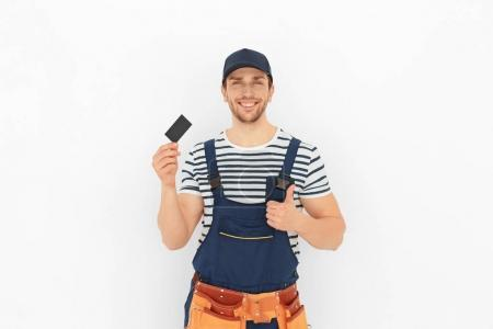 Handsome worker with business card