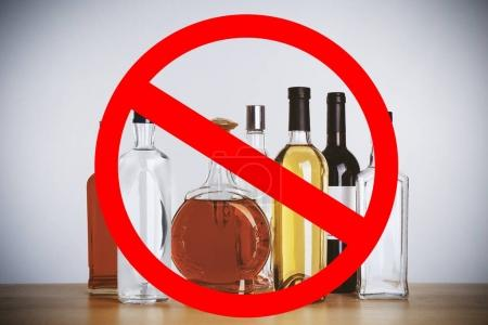 Different alcohol drinks with STOP sign