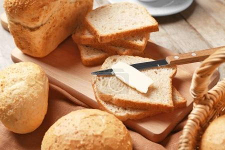 bread slices and piece of butter
