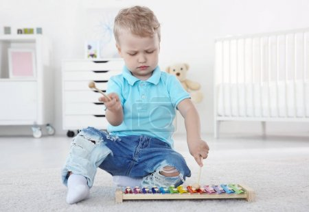 Cute little boy with xylophone