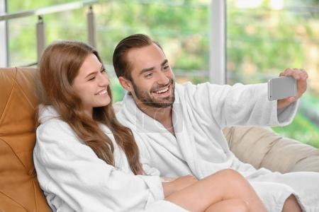 Young loving couple in bathrobes