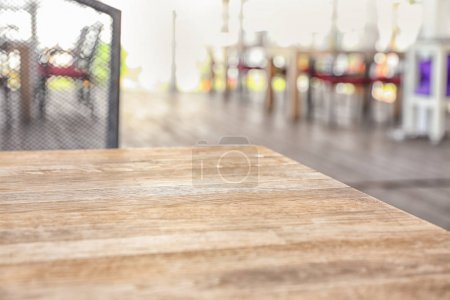 Wooden table on blurred background, closeup