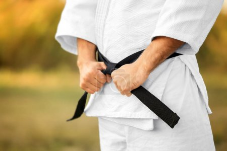 Male karate instructor outdoors, closeup...