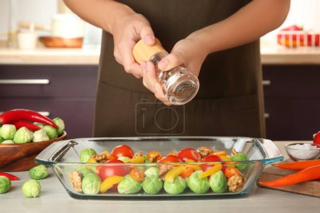 Woman cooking brussels sprouts