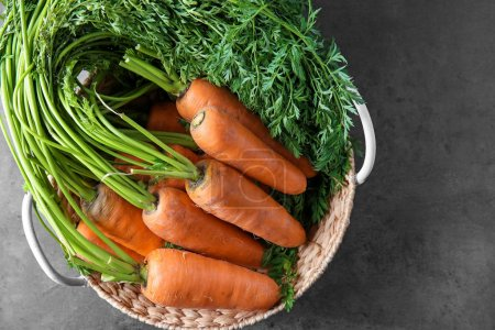 basket with ripe carrots