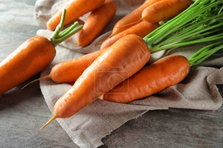 Photo for Tasty ripe carrots on table - Royalty Free Image