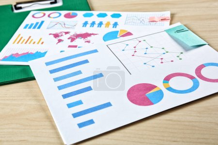 Photo for Documents with graphs and charts on table - Royalty Free Image