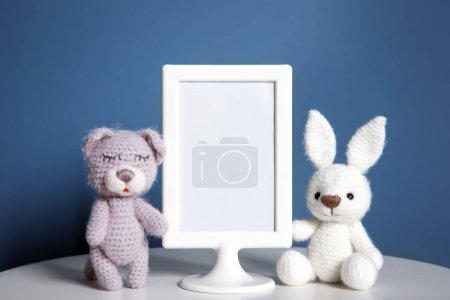 Mockup of blank frame with toys on color background