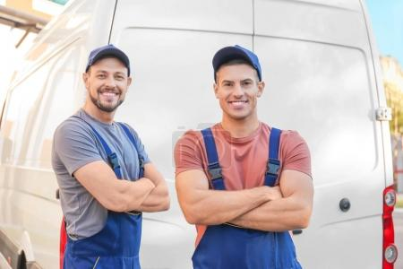 Photo for Delivery men standing near car - Royalty Free Image