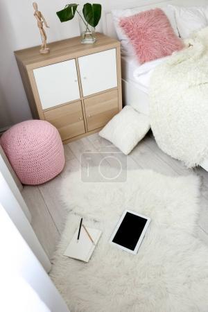 Modern bedroom interior with soft white carpet