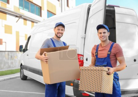 Photo for Delivery men with moving boxes near car - Royalty Free Image