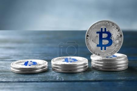 Silver bitcoins on wooden table