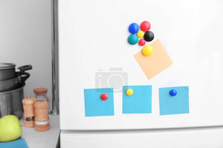 Blank notes with magnets on refrigerator door