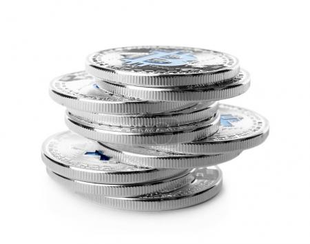 Stack of silver bitcoins on white background