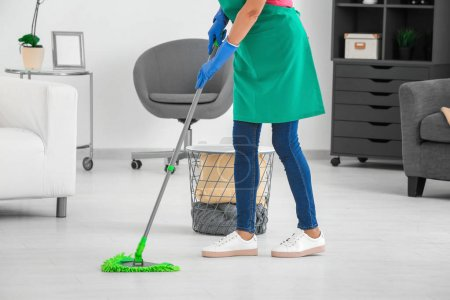 Woman mopping floor at home