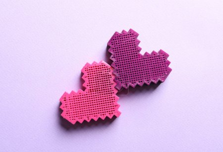 Two hearts on color background