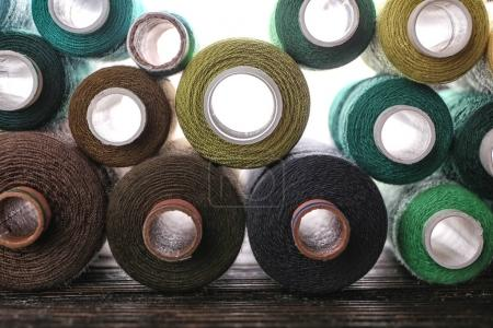 Set of color sewing threads on table