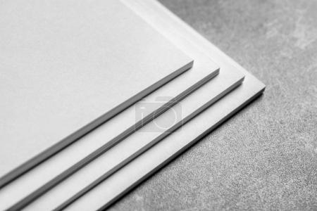 Blank sheets of paper on grey background. Mock up for design