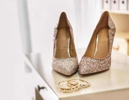 Pair of sparkly female shoes