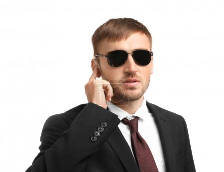 Handsome security guard on white background